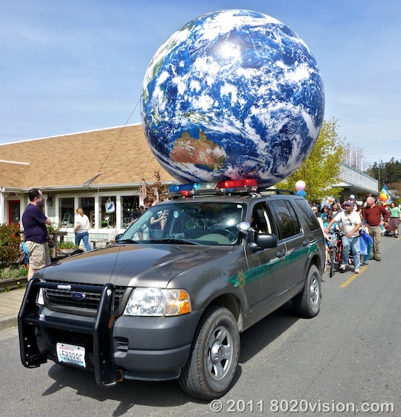 Earth Day parade police escort of Earth Ball